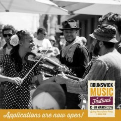 Flyer for Brunswick Music Festival showing black and white iamge of musicians inlcluding woman playing violin